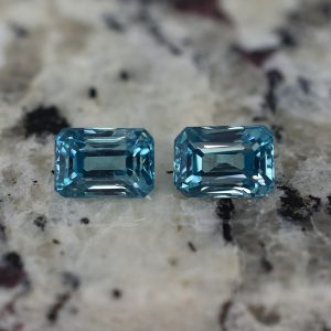 BlueZircon_eme_cut_pair_8.1x5.6_5.8mm_5.72cts_zn2355