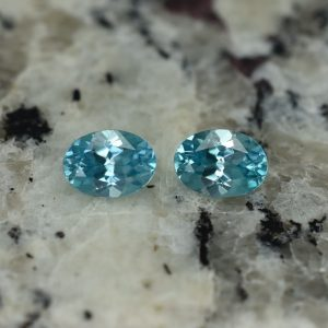 BlueZircon_oval_pair_7.5x5.5mm_3.00cts_zn2616